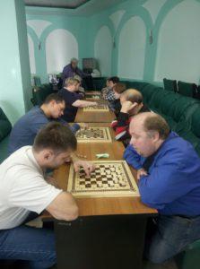 Соревнования по шашкам среди людей с ограниченными возможностями здоровья.